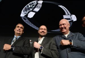 (L-R) Intel CEO Brian Krzanich, Google Andriod Engineering VP David Singleton and TAG Heuer CEO and President of LVMH Watch Division Jean-Claude Biver pose wearing titanium Carrera Connected watches unveiled in New York on November 9, 2015. Luxury Swiss watchmaker TAG Heuer launched the smartwatch aimed at taking on the Apple Watch, but with an asking price of 1,500 USD. TAG Heuer has joined forces with technology behemoths Google and Intel to develop a connected watch able to claw back some market share from Apple, which has shipped millions of its smartwatches since launching six months ago. The watch goes on sale November 9 in the US and will debut in Europe on November12. AFP PHOTO/JEWEL SAMAD